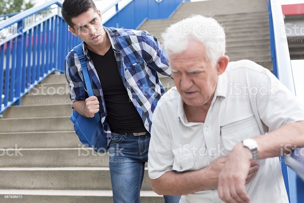 Man giving aid stock photo