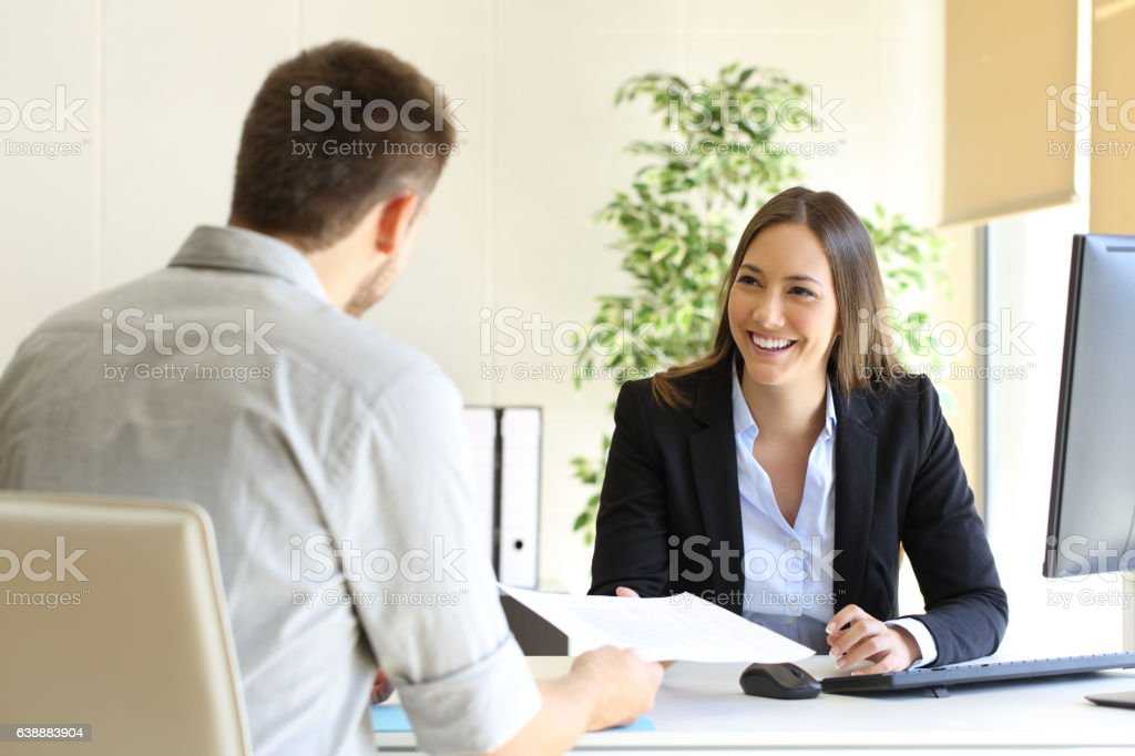 Man giving curriculum in a job interview stock photo