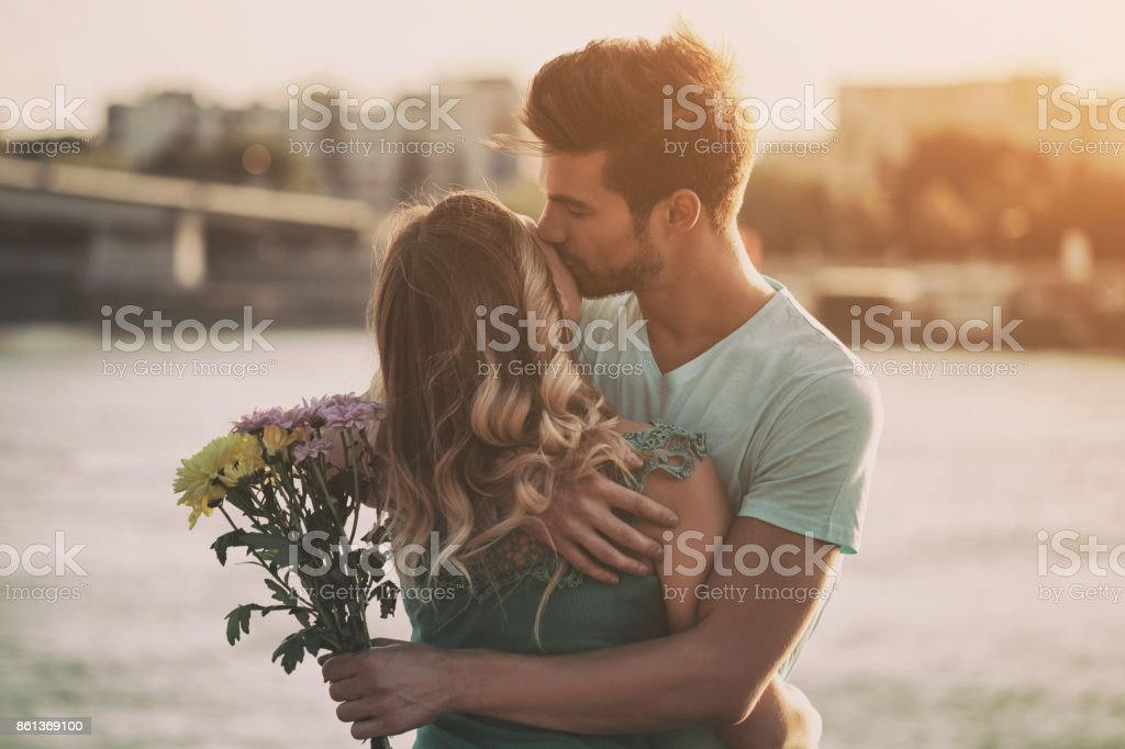 Man giving flowers to girlfriend royalty-free stock photo