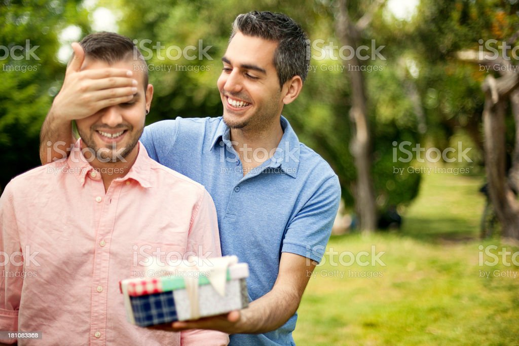 Man giving gift to his boyfriend royalty-free stock photo