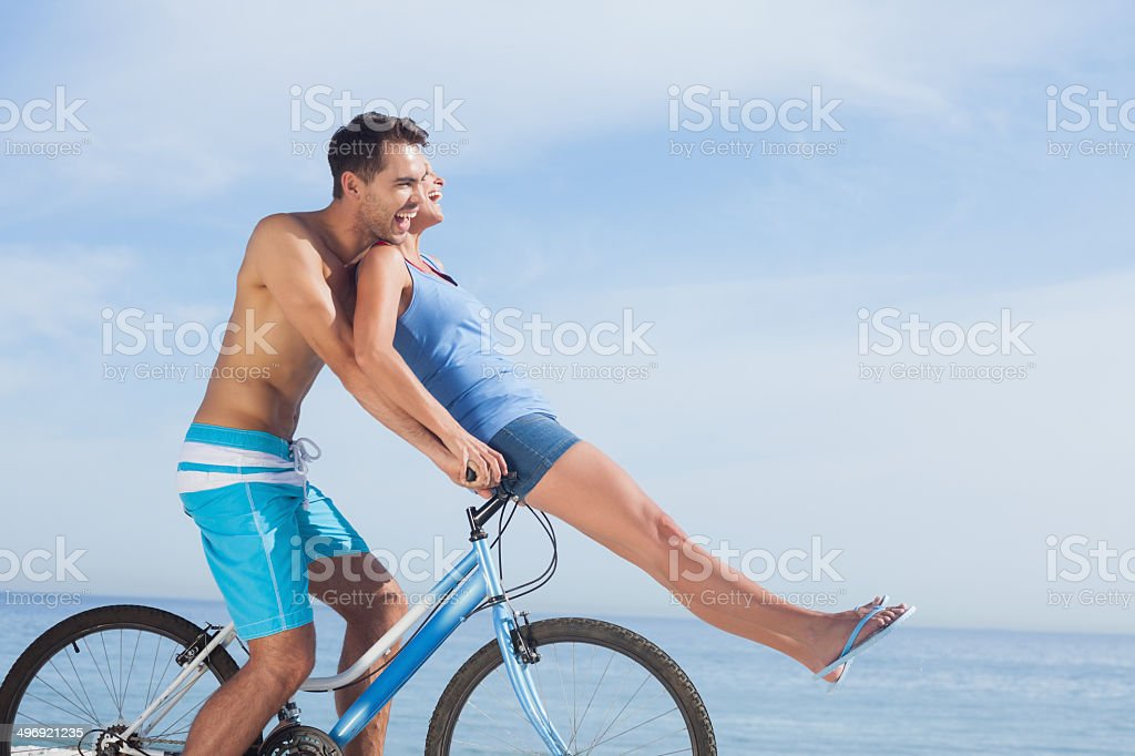 Man giving girlfriend a lift on his crossbar royalty-free stock photo