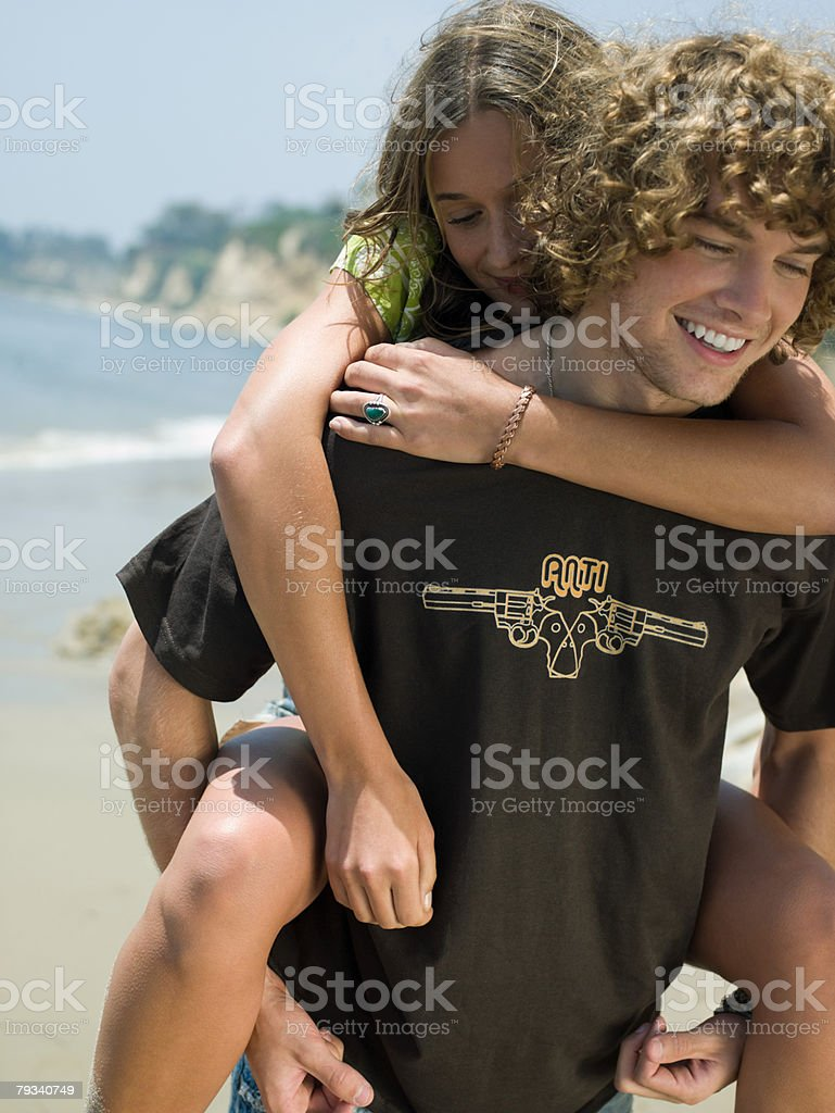 Man giving girlfriend a piggyback 免版稅 stock photo
