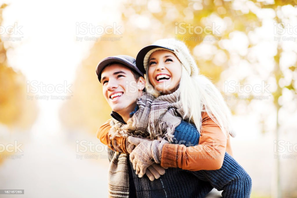 Man giving his girlfriend a piggyback ride. royalty-free stock photo