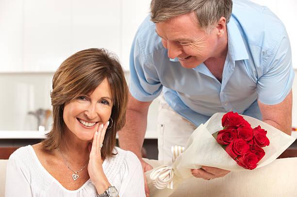 Man giving his happy wife roses picture id185263112?b=1&k=6&m=185263112&s=612x612&w=0&h=2l8gftqgdyivwf eo76i6vd5icttavrpbgpfj4ufvxc=