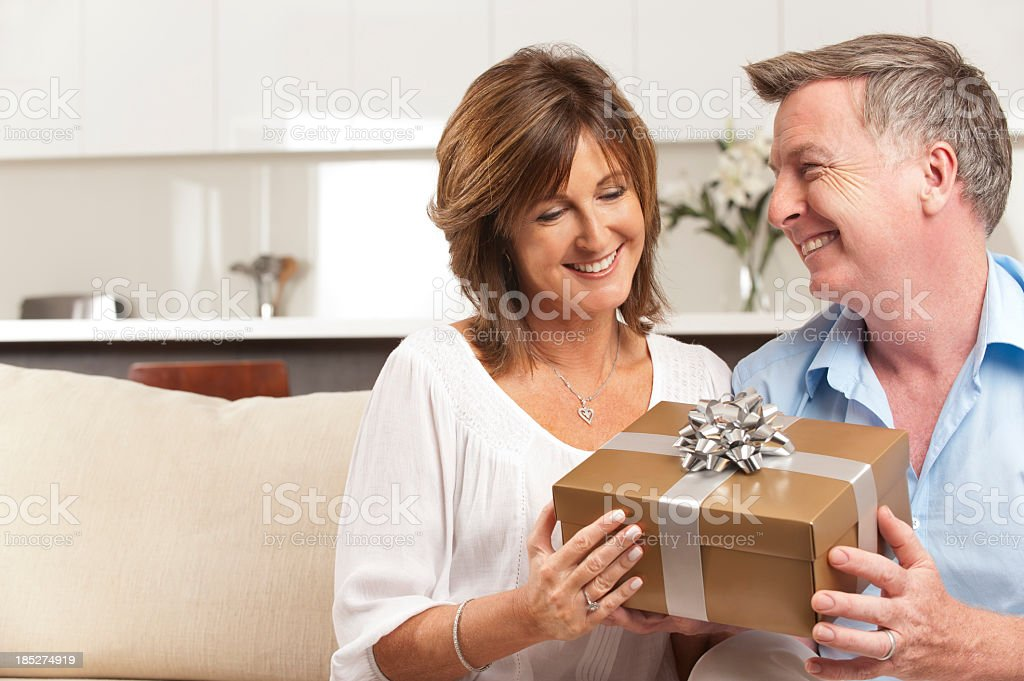 Man giving his wife a gift stock photo