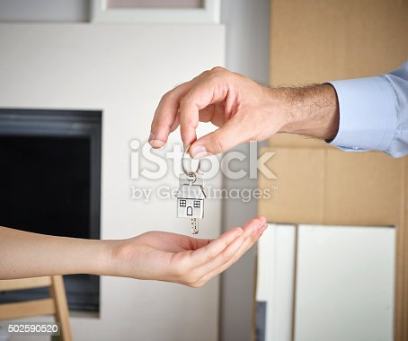 istock Man Giving Home Key To Woman 502590520