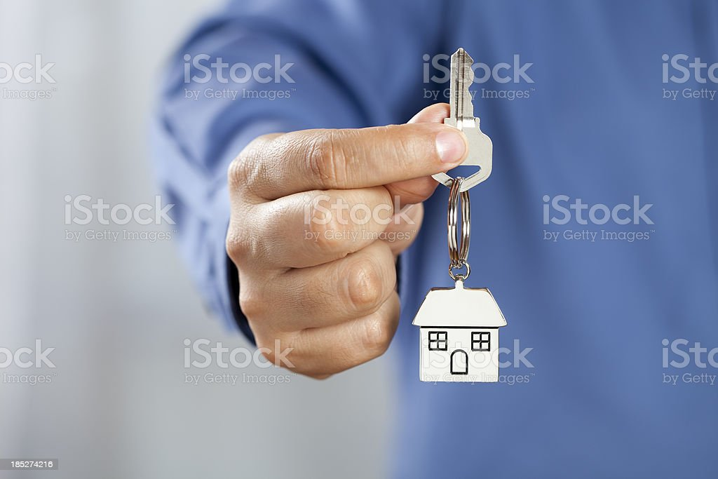 Man giving house keys royalty-free stock photo