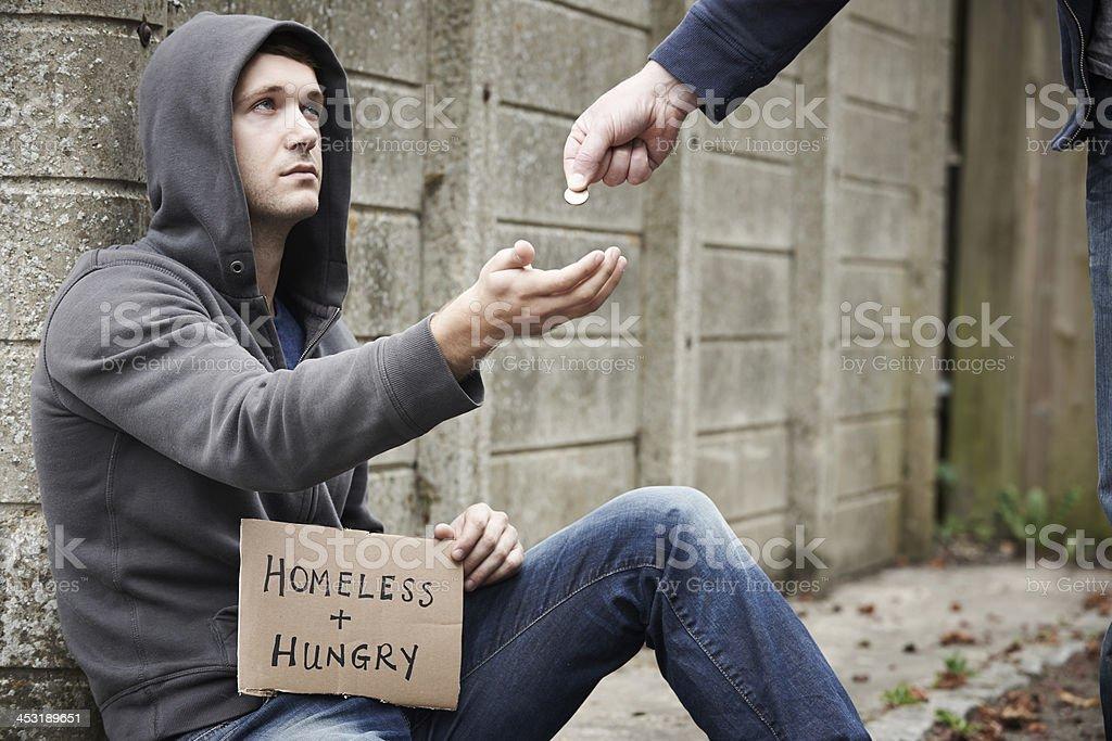 Man Giving Money To Beggar On Street stock photo