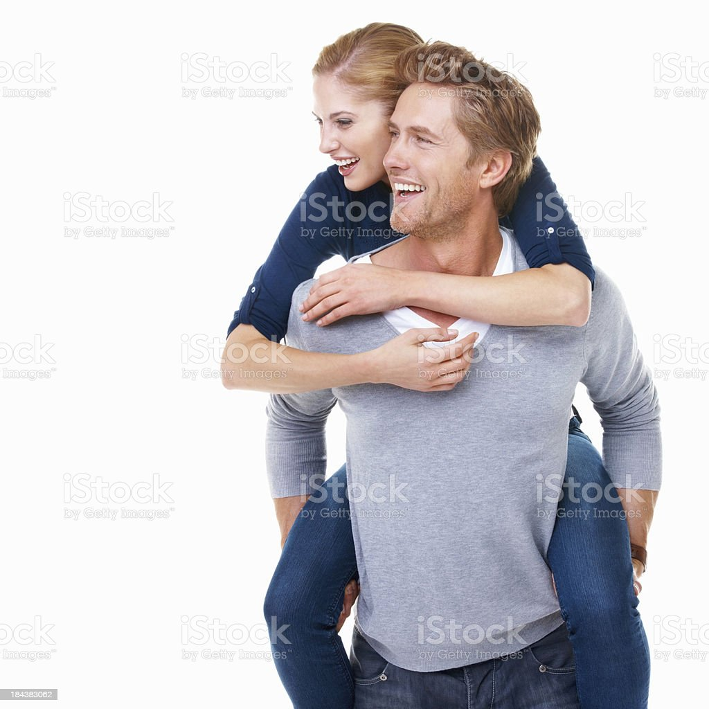 Man giving piggyback ride to young woman royalty-free stock photo