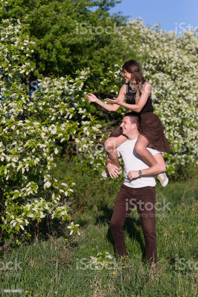Man giving piggyback woman 免版稅 stock photo