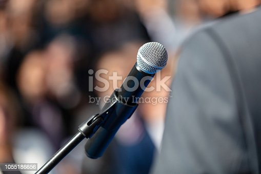 854811490 istock photo Man giving presentation 1055186656