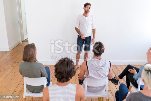 istock Man giving presentation to support group 923259072