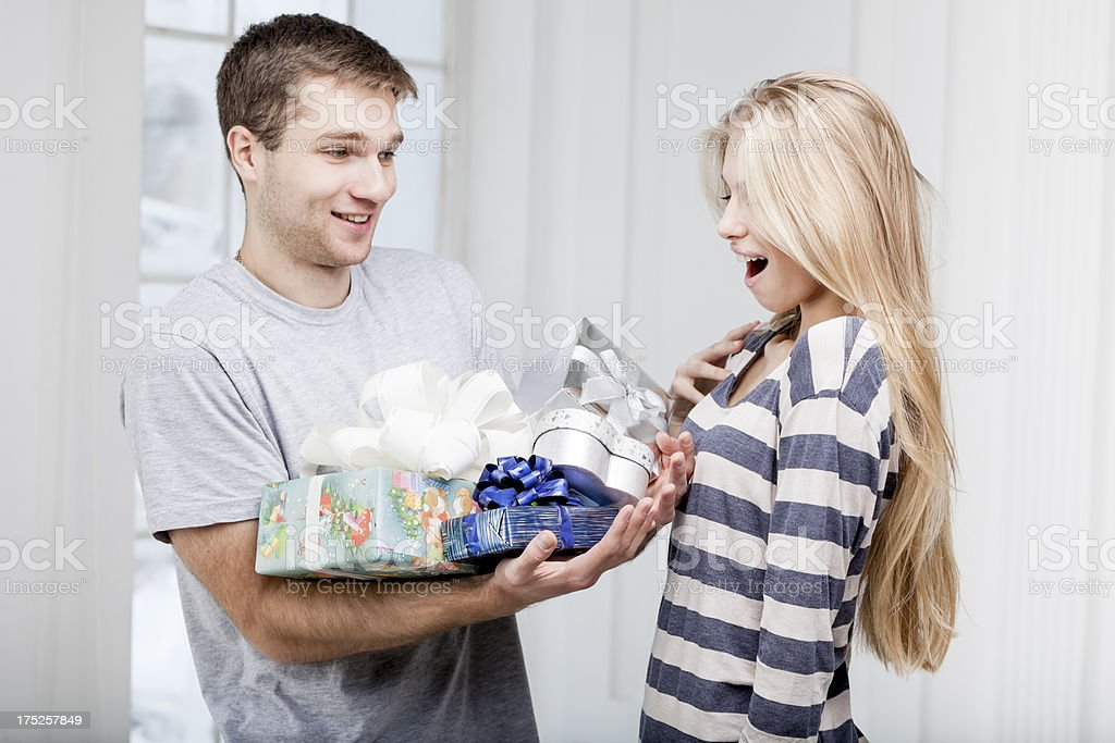 man giving presents to a young beautiful woman royalty-free stock photo