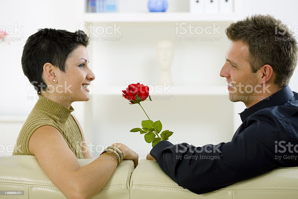 Man giving red rose to woman royalty-free stock photo