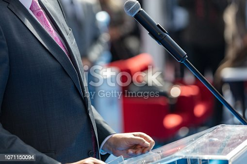 854811490 istock photo Man giving speech 1071150094