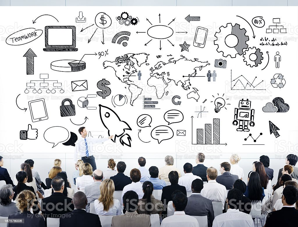 Man giving strategy presentation to large group royalty-free stock photo