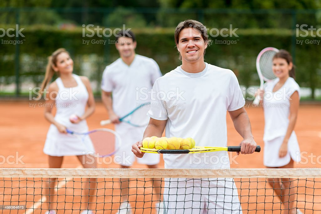 Man giving tennis lessons stock photo