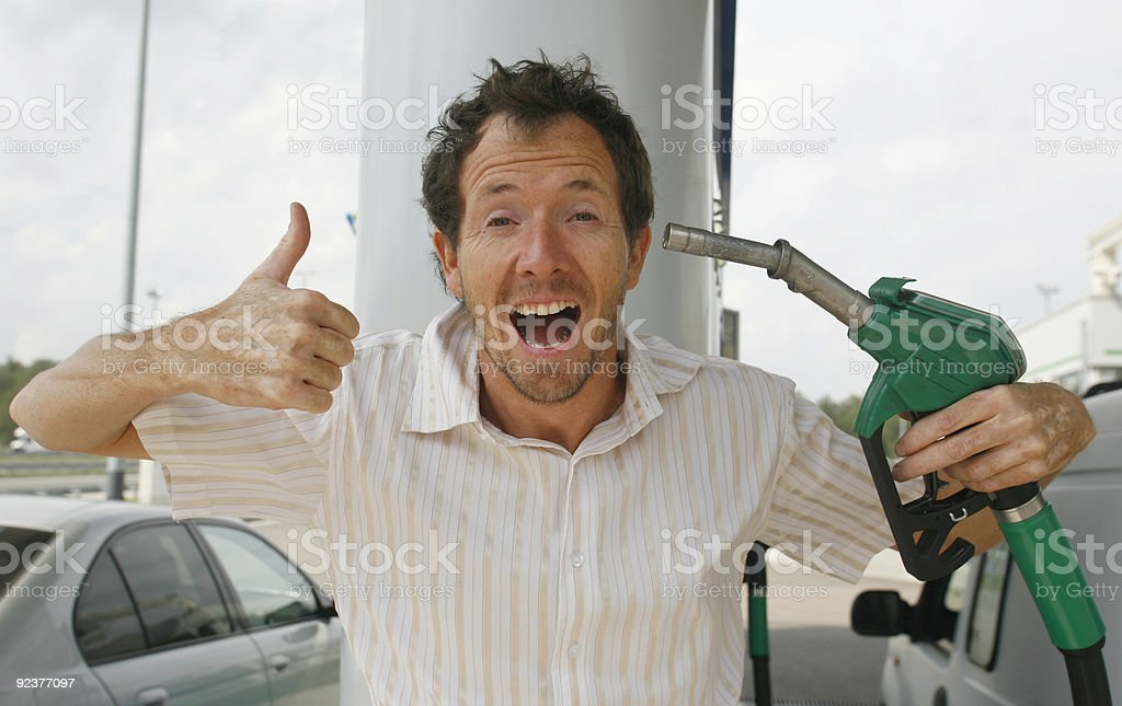 Man giving thumbs up getting gas royalty-free stock photo