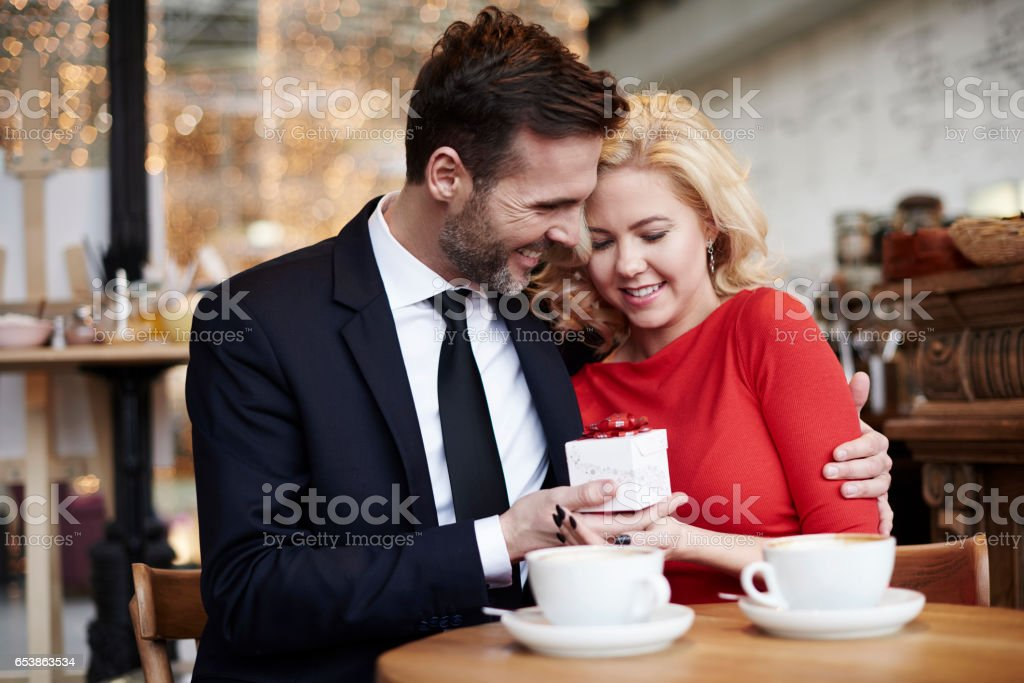 Man giving to his girlfriend little present stock photo