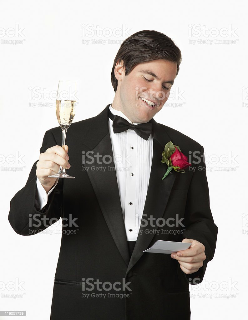 man giving toast wearing tuxedo royalty-free stock photo