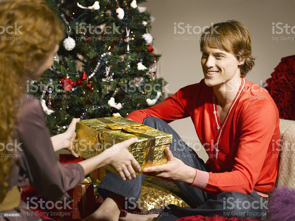 Man giving wife Christmas gift royalty-free stock photo