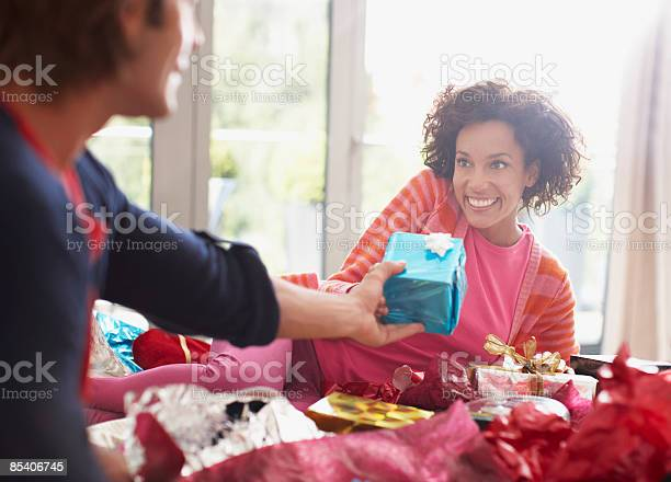Man giving wife christmas gift picture id85406745?b=1&k=6&m=85406745&s=612x612&h=1p9rzyi9u9knjxcv3ee 7eavzd1wh5ombxxuf5yykwm=