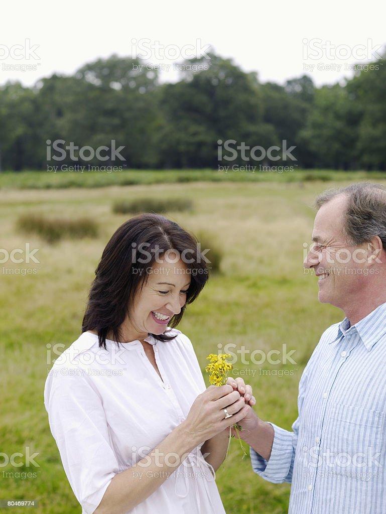 Man giving woman a flower 免版稅 stock photo