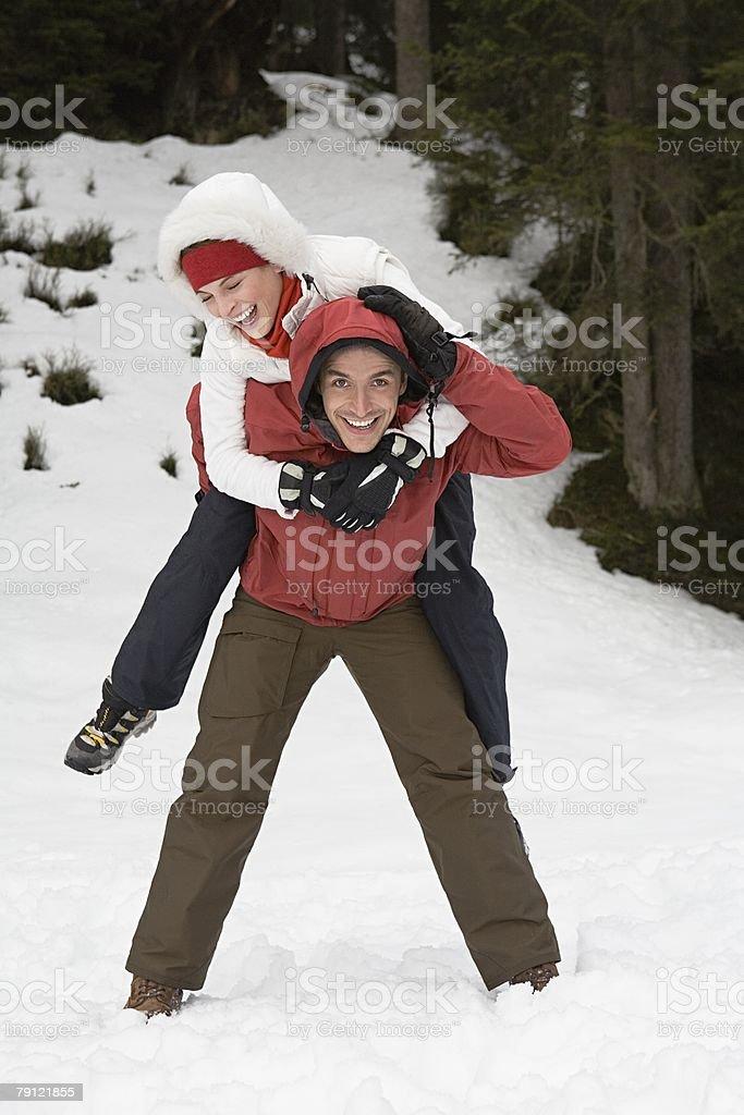 Man giving woman piggyback royalty-free stock photo