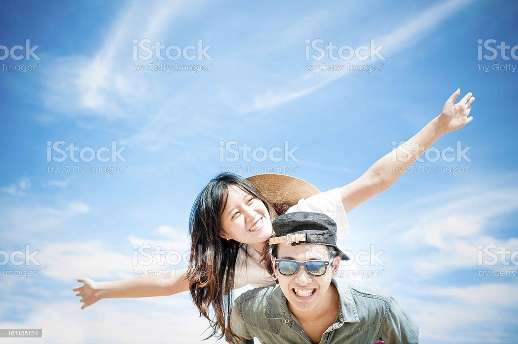 Man giving woman piggyback ride at the beach. royalty-free stock photo