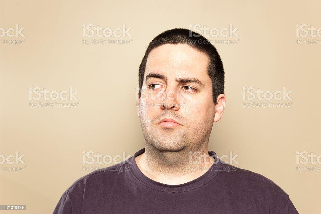 Man glances sideways suspiciously stock photo