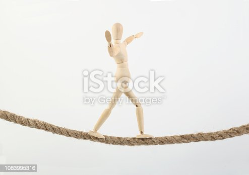 Man goes along a rope