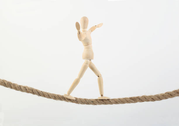 Man goes along a rope Man goes along a rope ventriloquist's dummy stock pictures, royalty-free photos & images