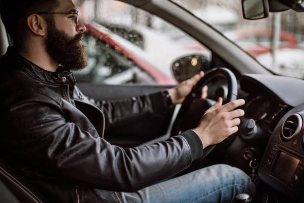 man goes out of the parking lot - jacket stock photos and pictures