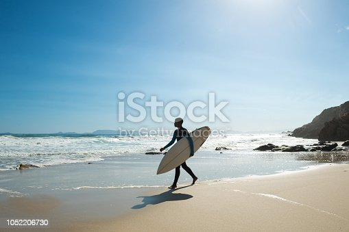 Male surfer on the coastline of Western Cape Province near Cape Town, South Africa