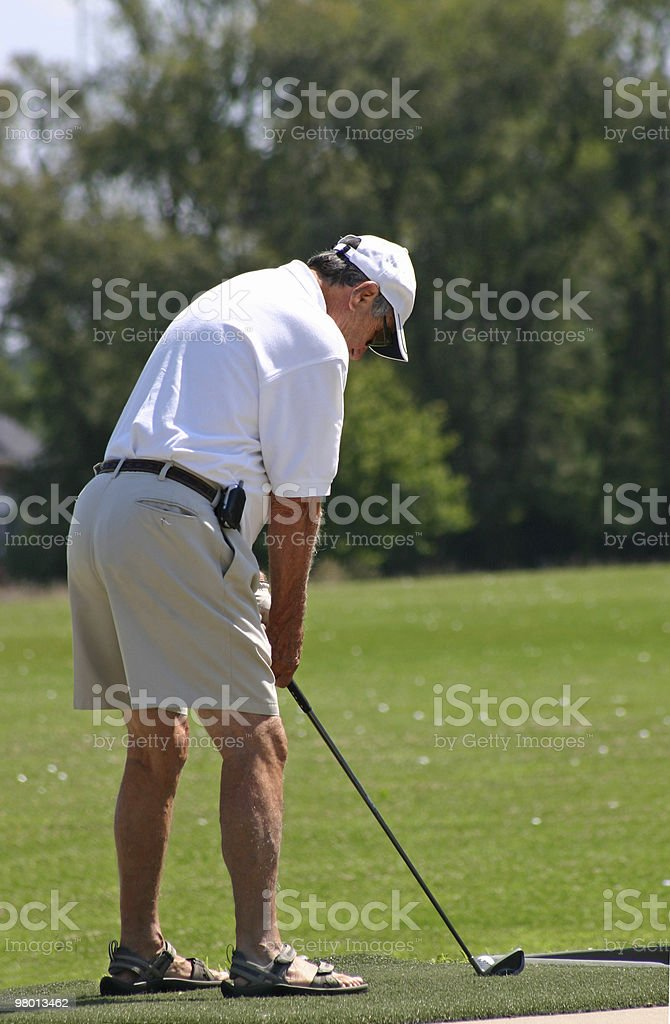 Man Golfing royalty free stockfoto