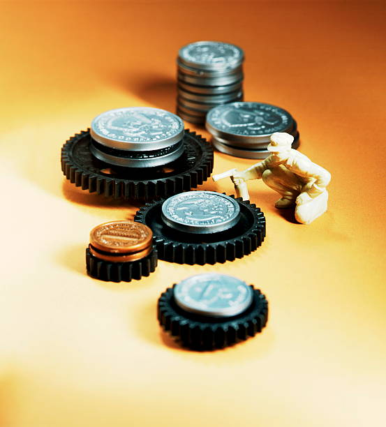 Man Greasing Money Cogs stock photo