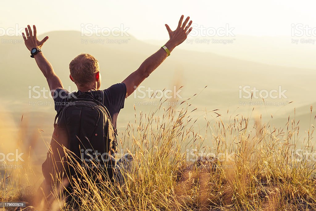 Man greeting golden rising of the sun stock photo