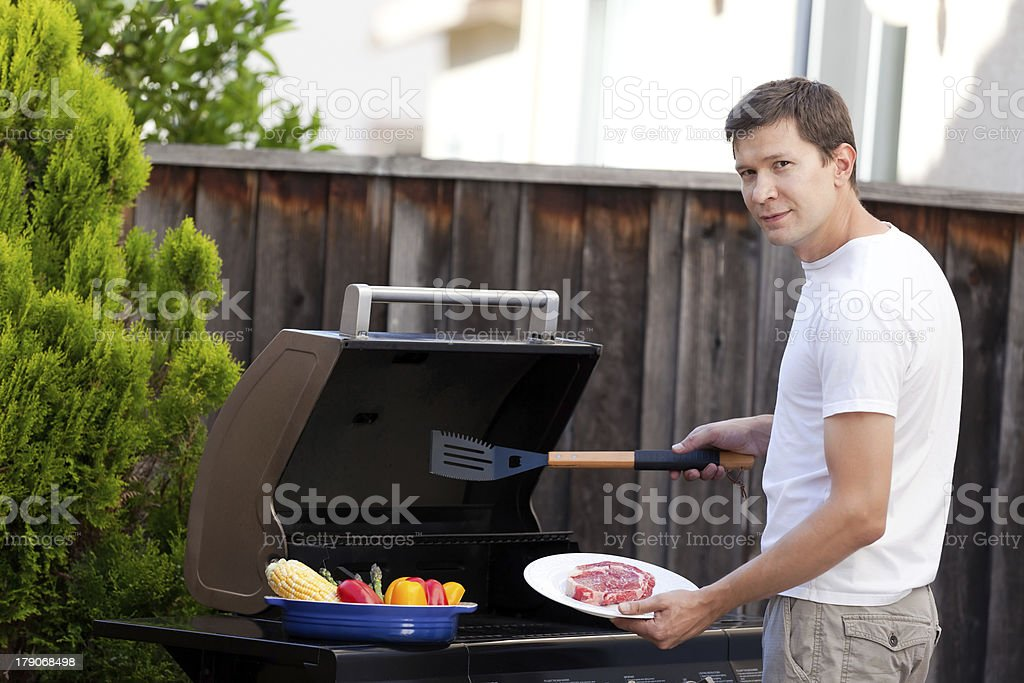 man grilling food royalty-free stock photo