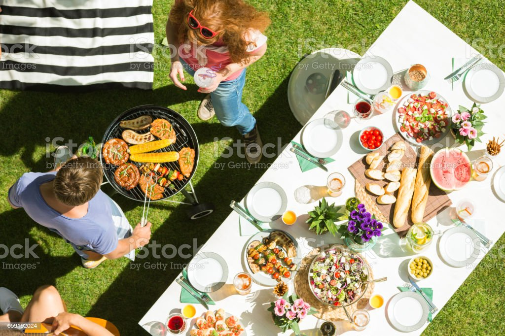 Man grilling food stock photo