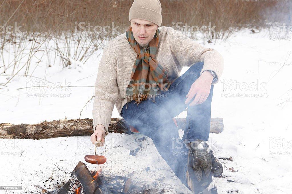 Man grilling sausage royalty-free stock photo