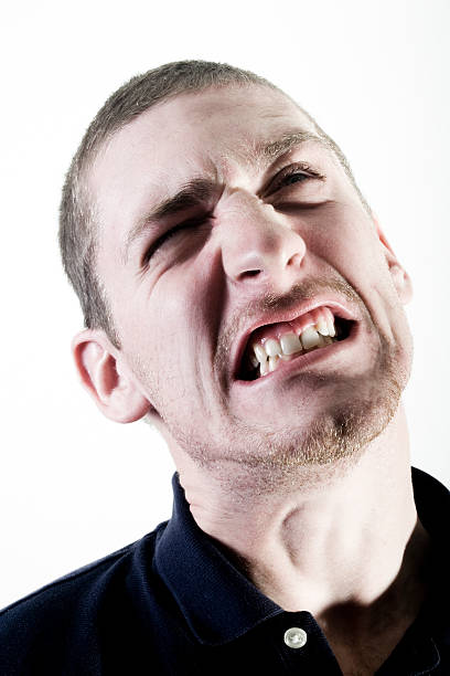 Man grimacing stock photo