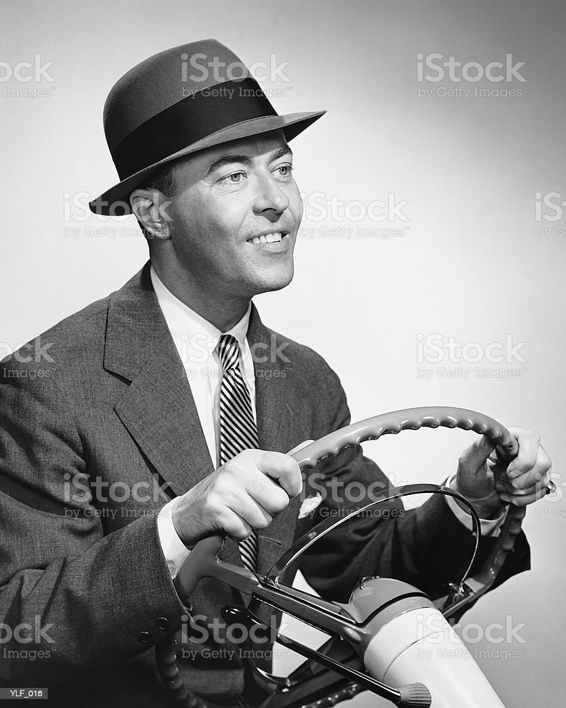 Man gripping steering wheel royalty-free stock photo
