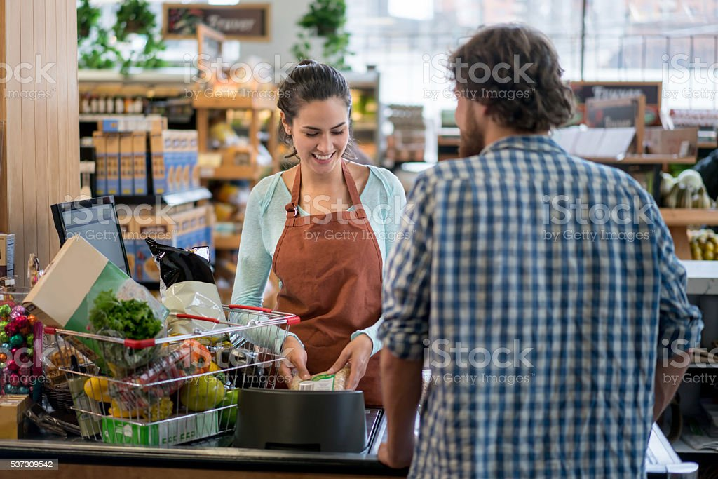 Man grocery shopping at the supermarket stock photo