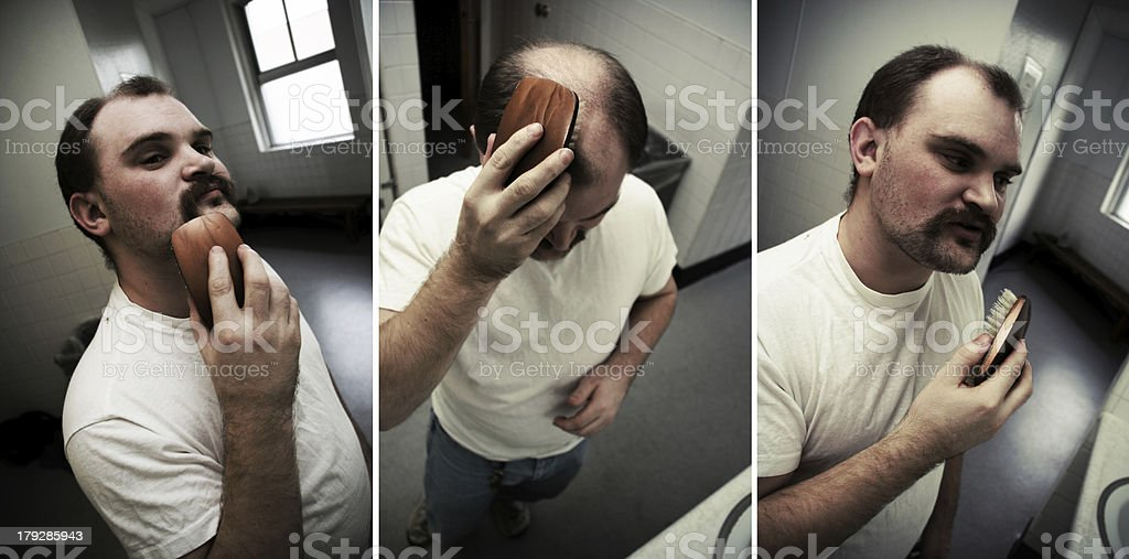 Man Grooming his Hair and Mustache royalty-free stock photo