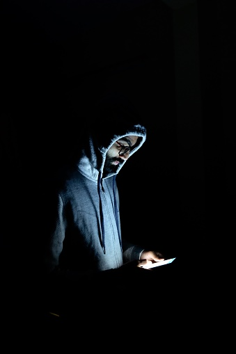 Wearing hoodie and watching in mobile, mobility, apps, digital life
