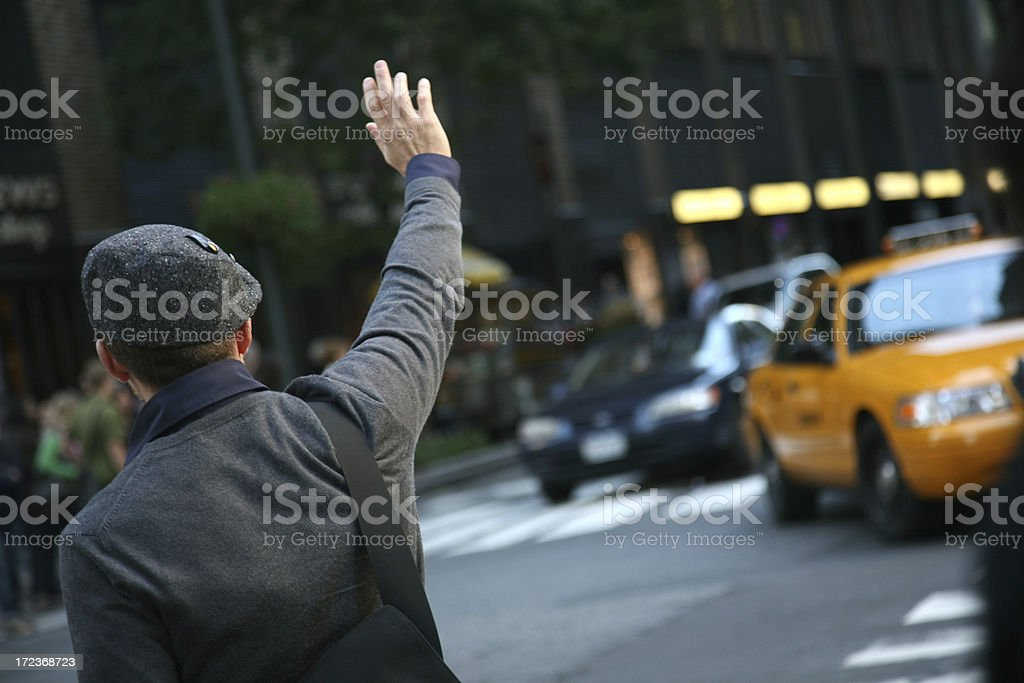 Man Hailing Cab From Street stock photo