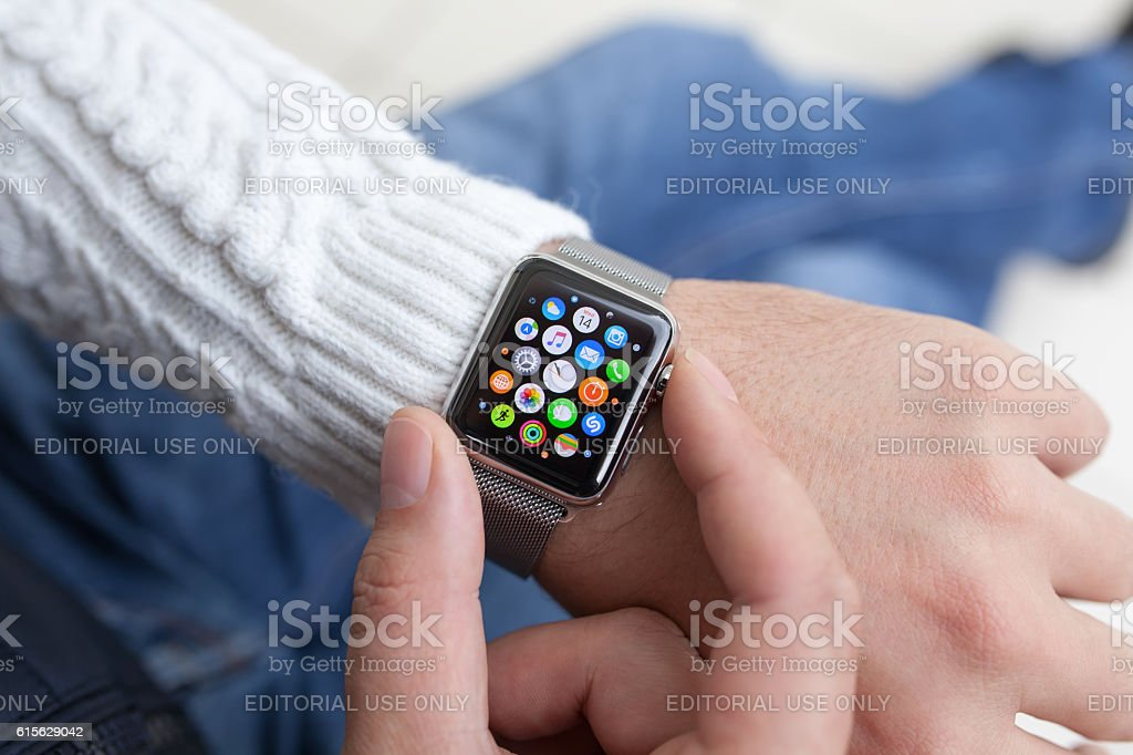 Man hand and Apple Watch with app on the screen stock photo
