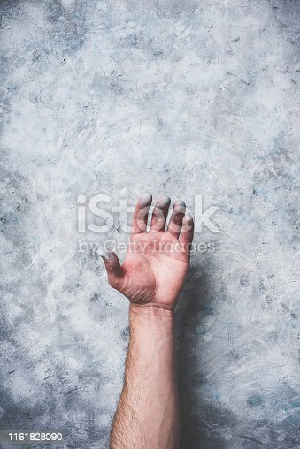 istock Man hand covered with paint 1161828090