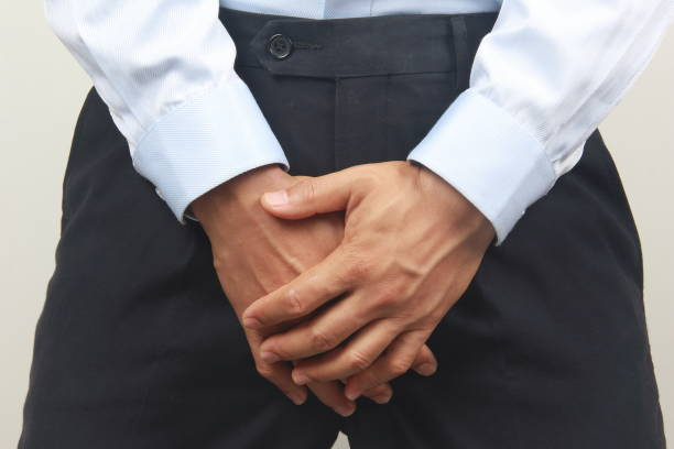 Man hand covering his crotch Man hand covering his crotch erectile dysfunction stock pictures, royalty-free photos & images