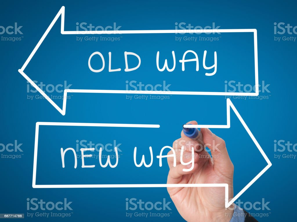 Man Hand drawing Old Way or New Way concept with marker on visual screen stock photo